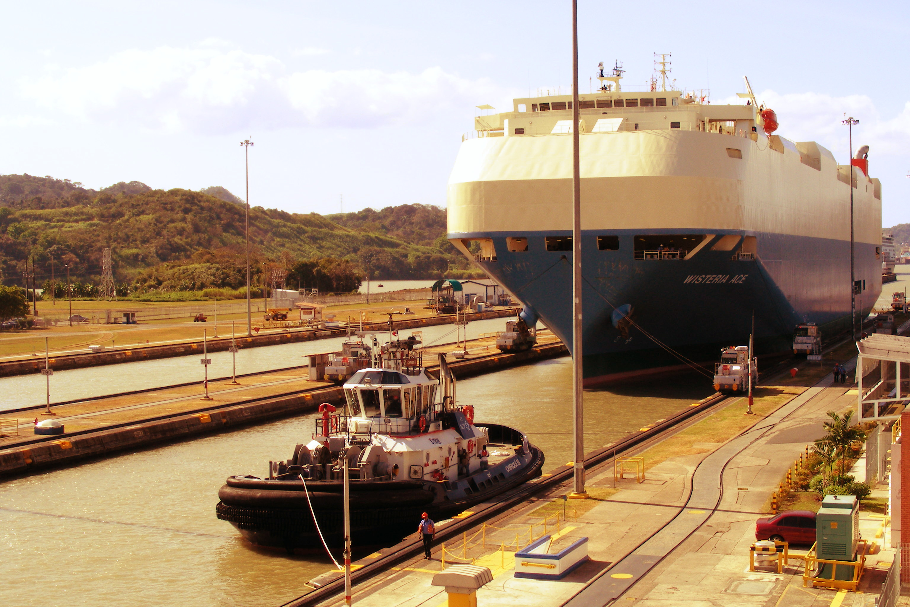 Tugboat_and_a_Ship_-_Panama_Canal